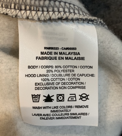 Photo of the tag on Nike Sportswear club fleece hoodie - fabric and wash instructions